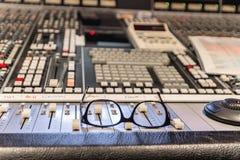 Glasses on the mixer at recording studio. Break in audio studio recording Royalty Free Stock Photo