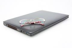 Glasses on modern laptop Royalty Free Stock Photo