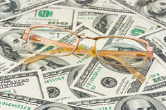 Glasses on money Stock Photos