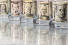 The glasses and money on the glass table Royalty Free Stock Image