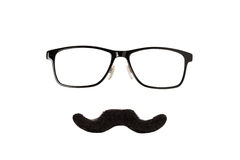 Glasses and Moustache. Glasses and Black Moustache Isolated on a White Background Royalty Free Stock Photos