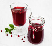 Glasses of mulled wine with  cranberries. On a old white wooden background Stock Photos