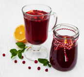 Glasses of mulled wine with  cranberries. On a old white wooden background Royalty Free Stock Image