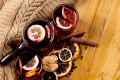 Glasses of mulled wine with dry citrus and spices ,knitted sweater stock image