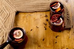 Glasses of mulled wine with dry citrus and spices ,knitted sweater royalty free stock image