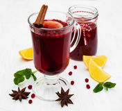 Glasses of mulled wine with lemon and cranberries. On a old white wooden background Stock Images