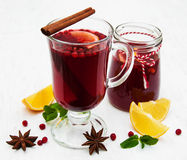 Glasses of mulled wine with lemon and cranberries. On a old white wooden background Royalty Free Stock Images