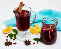 Glasses of mulled wine with lemon and cranberries Stock Images