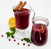 Glasses of mulled wine with lemon and cranberries. On a old white wooden background Stock Photo