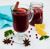 Glasses of mulled wine with lemon and cranberries. On a old white wooden background Stock Image