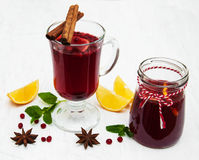 Glasses of mulled wine with lemon and cranberries Royalty Free Stock Image