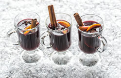 Glasses of mulled wine in snow Royalty Free Stock Photography