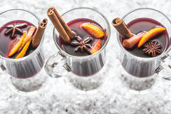 Glasses of mulled wine in snow Royalty Free Stock Photo