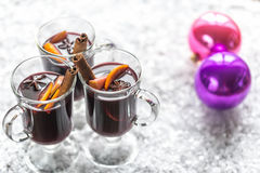 Glasses of mulled wine in snow Royalty Free Stock Photos