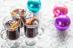 Glasses of mulled wine in snow Stock Images