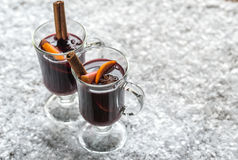 Glasses of mulled wine in snow Stock Photos