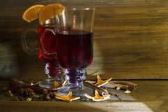 Glasses of mulled wine on a wooden background Royalty Free Stock Photos