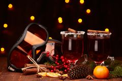Glasses of mulled wine on wooden table Stock Photos