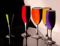Glasses with multi-colored liquid royalty free stock photo