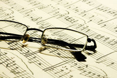 Glasses and music notes Royalty Free Stock Photos