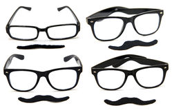 Glasses with Mustaches. Collection of 4 black glasses with fake mustaches isolated on white background Stock Photo