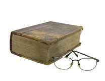 Glasses near very old bible. On the white background Stock Image
