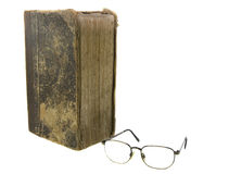 Glasses near very old bible Stock Image