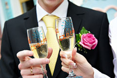 Glasses newlyweds for good luck Stock Photos