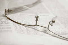 GLASSES ON A NEWSPAPER Royalty Free Stock Images