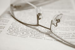 GLASSES ON A NEWSPAPER Royalty Free Stock Photography