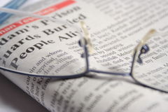 GLASSES ON A NEWSPAPER Royalty Free Stock Image