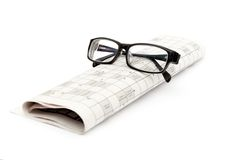 Glasses and newspaper Stock Photography