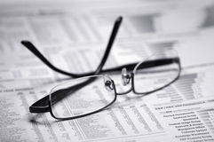 Glasses on a newspaper. Black and white stock photo