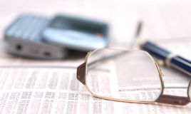 Glasses on a newspaper Stock Image