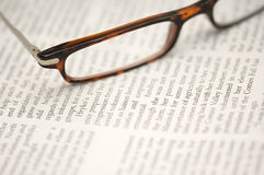 Glasses on a newspaper Royalty Free Stock Photo