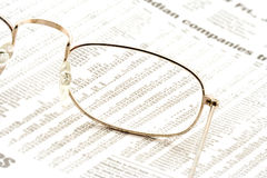Glasses on a newspaper. In the stock section stock photos