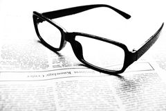Glasses on newspaper royalty free stock photo