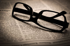 Glasses on newspaper Royalty Free Stock Photos