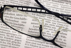 Glasses and newspaper Royalty Free Stock Photo