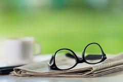 Glasses on newspaper. Break broadsheet business coffee communication computer Royalty Free Stock Photos