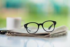 Glasses on newspaper. Break broadsheet business coffee communication computer Royalty Free Stock Image