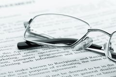 Glasses on newspaper. Macro view Stock Photo