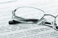Glasses on newspaper. Macro view Stock Photo