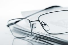 Glasses on newspaper. Toned image Royalty Free Stock Photos