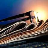 Glasses on newspapers Royalty Free Stock Photo