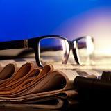 Glasses on newspapers Stock Images
