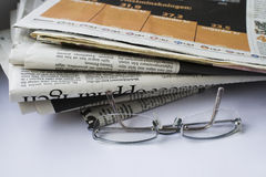 Glasses and newspapers. Royalty Free Stock Images
