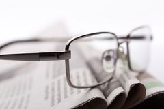 Glasses on the newspapers closeup Royalty Free Stock Images