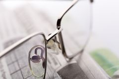 Glasses on the newspapers closeup view Royalty Free Stock Image