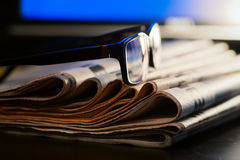 Glasses and newspapers journalism concept Stock Photo